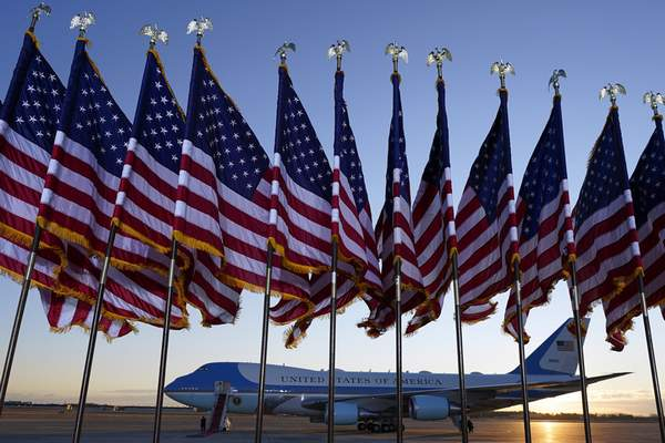 Air Force One is prepared for President Donald Trump as flags fly on a stage at Andrews Air Force Base, Md., Wednesday, Jan. 20, 2021.(AP Photo/Manuel Balce Ceneta)