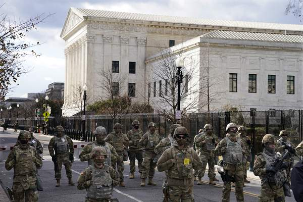 Associated Press Members of the National Guard stand at a road block near the Supreme Court ahead of President-elect Joe Biden's inauguration ceremony Wednesday in Washington.