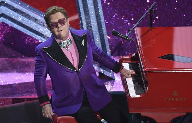 """Associated Press Dozens of U.K. music stars including Elton John say musicians have been """"shamefully failed"""" by the British government, which has left them facing post-Brexit restrictions on touring in the EU."""