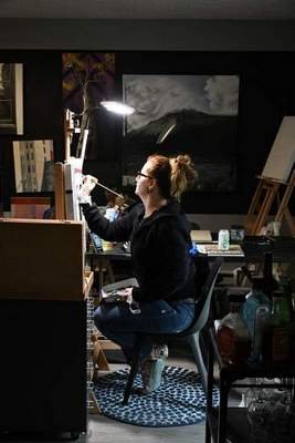 Courtesy Matthew Murr Angola native Krystal Booth paints inside her home in Portland, Ore.