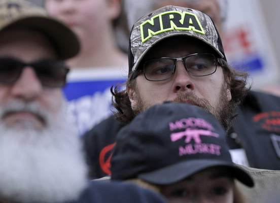 FILE †In this Jan. 18, 2019, file photo, an attendee at a gun-rights rally wears a hat supporting the National Rifle Association, at the Capitol in Olympia, Wash. (AP Photo/Ted S. Warren, File)