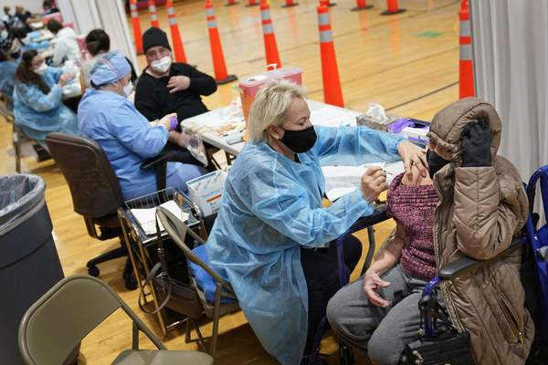 Miriam Palomino, right, received the COVID-19 vaccine in Paterson, N.J., Thursday, Jan. 21, 2021. (AP Photo/Seth Wenig)