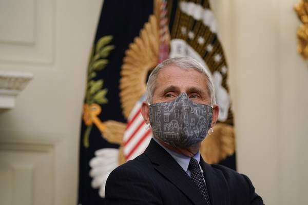 Dr. Anthony Fauci, director of the National Institute of Allergy and Infectious Diseases, listens during an event with President Joe Biden on the coronavirus in the State Dinning Room of the White House, Thursday, Jan. 21, 2021, in Washington. (AP Photo/Alex Brandon)