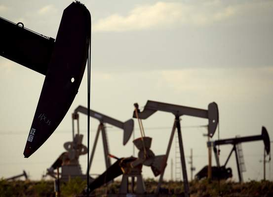 FILE - In this April 24, 2015, file photo, pumpjacks work in a field near Lovington, N.M. In the closing months of the Trump administration, energy companies stockpiled enough drilling permits for western public lands to keep pumping oil for years. (AP Photo/Charlie Riedel, File)