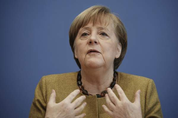 German Chancellor Angela Merkel talks to the media during a press conference on the current situation in Berlin, Germany, Thursday, Jan. 21, 2021. (Michael Kappeler/Pool via AP)