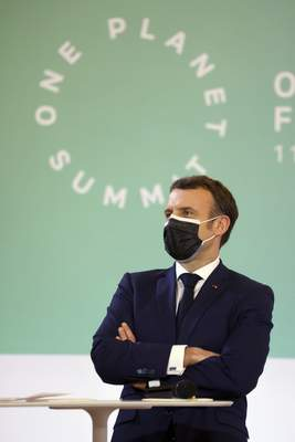 FILE - In this Jan. 11, 2021 file photo, French President Emmanuel Macron stands during the One Planet Summit, at The Elysee Palace, in Paris, France. (Ludovic Marin, Pool Photo via AP, File)