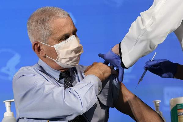 FILE - In this Dec. 22, 2020, file photo, Dr. Anthony Fauci, director of the National Institute of Allergy and Infectious Diseases, prepares to receive his first dose of the COVID-19 vaccine at the National Institutes of Health in Bethesda, Md. (AP Photo/Patrick Semansky, Pool, File)