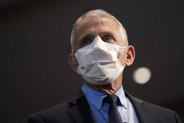 FILE - In this Dec. 22, 2020, file photo, Dr. Anthony Fauci, director of the National Institute of Allergy and Infectious Diseases, speaks before receiving his first dose of the COVID-19 vaccine at the National Institutes of Health, in Bethesda, Md. (AP Photo/Patrick Semansky, Pool, File)
