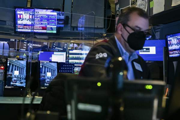 In this photo provided by the New York Stock Exchange, a trader works in a booth on the trading floor, Wednesday, Jan. 20, 2021. (Colin Ziemer/New York Stock Exchange via AP)