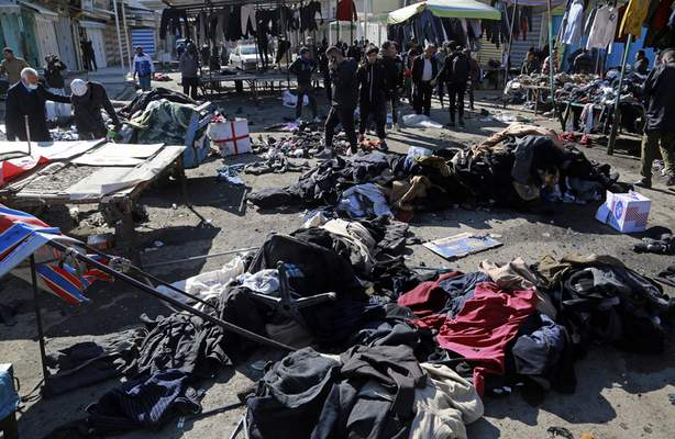 Security forces work at the site of a deadly bomb attack in Baghdad, Iraq, Thursday, Jan. 21, 2021. (AP Photo/Hadi Mizban)