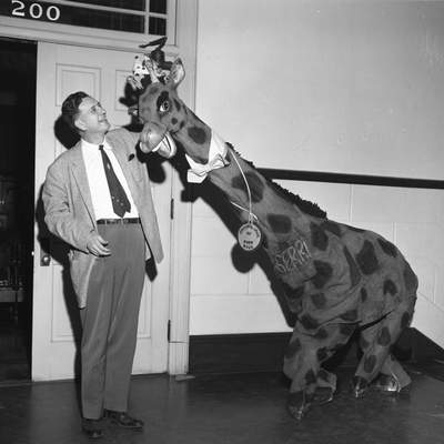 Jan. 21, 1958: Mayor Robert E. Meyers crowns Gerri the Giraffe as Ambassador of Good Will for the Sports, Vacation and Boat Show that was to open later that week at Memorial Coliseum. (Journal Gazette file photo)