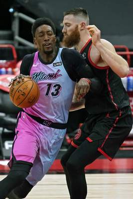 Associated Press Heat center Bam Adebayo, left, crashes into Aron Baynes during the first half Wednesday in Tampa, Fla.