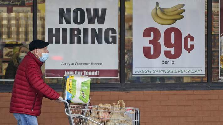 Workers were being sought earlier this month at a Mayfield Heights, Ohio, grocery store. More than half the 22 million jobs lost to the pandemic last spring have been regained.
