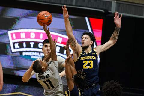 Michigan Purdue Basketball Michigan forward Brandon Johns Jr. (23) goes up to block the shot of Purdue guard Isaiah Thompson (11) during the first half of an NCAA college basketball game in West Lafayette, Ind., Friday, Jan. 22, 2021. (AP Photo/Michael Conroy) (Michael Conroy STF)