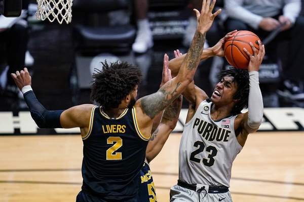 Purdue guard Jaden Ivey (23) shoots over Michigan forward Isaiah Livers (2) during the second half of an NCAA college basketball game in West Lafayette, Ind., Friday, Jan. 22, 2021. (AP Photo/Michael Conroy)