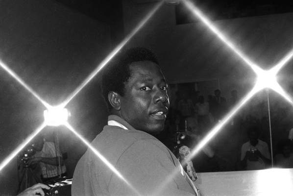 Atlanta Braves' Hank Aaron looks over his shoulder during a news conference in New Orleans, Monday, April 1, 1974. Aaron is only one home run from tying and two from breaking Babe Ruths all-time home run record. (AP Photo)