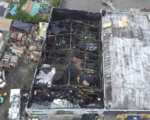 FILE - This undated file photo provided by the City of Oakland shows inside the burned warehouse after the deadly fire that broke out on Dec. 2, 2016, in Oakland, Calif. Derick Almena, who is facing a second trial after a fire killed 36 partygoers at a San Francisco Bay Area warehouse he's accused of illegally converting into a cluttered artists enclave is expected to plead guilty later this month, relatives of several of the victims said. Almena, 50, is expected to plead guilty to 36 counts of involuntary manslaughter on Jan. 22, 2021, families of several fire victims told the East Bay Times Wednesday, Jan. 13. (City of Oakland via AP, File)