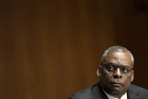 Secretary of Defense nominee Lloyd Austin, a recently retired Army general, listens during his conformation hearing before the Senate Armed Services Committee on Capitol Hill, Tuesday, Jan. 19, 2021, in Washington. (Greg Nash/Pool via AP)