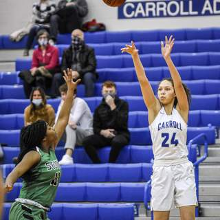 Mike Moore | The Journal Gazette Carroll guard Jasmine Anderson shoots the ball over a South Side defender during the second quarter Friday night.