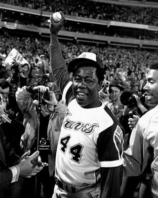 Hank Aaron holds the ball he hit for his record-breaking 715th career home run on  April 8, 1974, in Atlanta against the Los Angeles Dodgers.