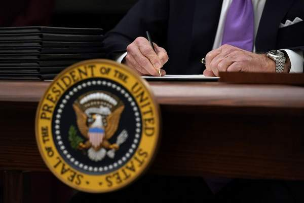 In this Jan. 21, 2021, file photo President Joe Biden signs executive orders after speaking about the coronavirus in the State Dinning Room of the White House in Washington. (AP Photo/Alex Brandon, File)