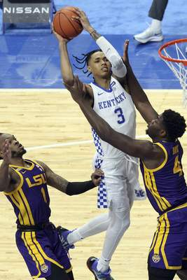 Kentucky's B.J. Boston, top, shoots while defended by LSU's Ja'Vonte Smart, left, and Darius Days (4) during the second half of an NCAA college basketball game in Lexington, Ky., Saturday, Jan. 23, 2021. (AP Photo/James Crisp)