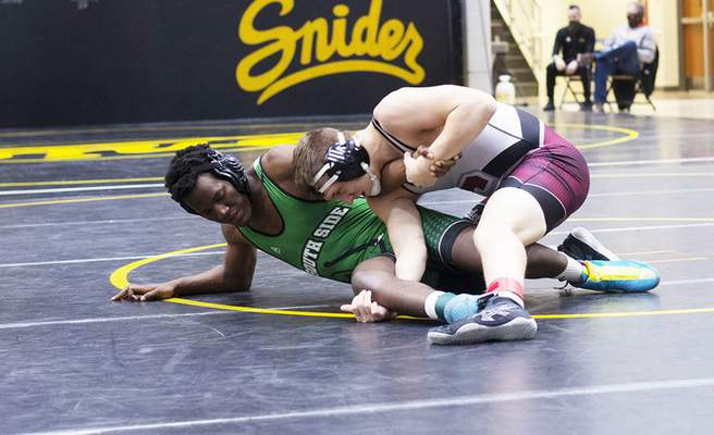 Katie Fyfe | The Journal Gazette  South Side's Robert Cole wrestles against Concordia's Sam Hudson in the 170 weight class during the SAC Wrestling Championships at Snider High School on Saturday.