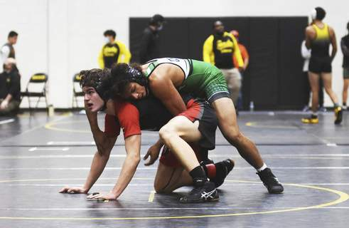 Katie Fyfe | The Journal Gazette  South Side's Matthew Morris wrestles against Bishop Luers' Dylan Pocock in the 170 weight class during the SAC Wrestling Championships at Snider High School on Saturday.