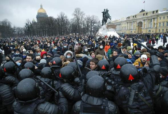 Associated Press People clash with police Saturday in St. Petersburg, Russia, during a protest against the jailing of opposition leader Alexei Navalny. Russia saw nationwide protests, and more than 3,000 people were arrested.