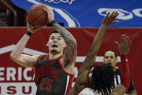 Ohio State Wisconsin Basketball Associated Press Ohio State's Kyle Young shoots over Wisconsin's Aleem Ford during the second half Saturday in Madison, Wis.  (Morry GashSTF)