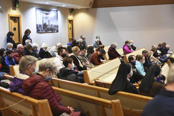 Attendees pray Saturday afternoon during the 47th March for Life Prayer Gathering at Abundant Life Church.