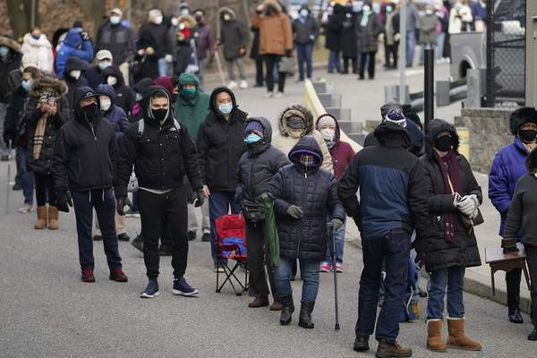 Associated Press People wait in line for the COVID-19 vaccine in Paterson, N.J., on Thursday.