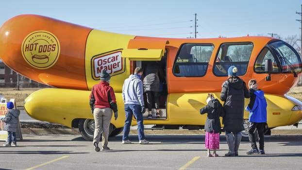 Mike Moore | The Journal Gazette Spectators gather in the Science Central parking lot  Saturday to catch a  glimpse of the iconic Oscar Mayer Wienermobile, in town on a coast-to-coast tour.