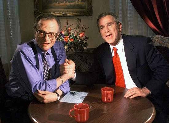 """Associated Press Larry King jokes with President George W. Bush in 1999, then the governor of Texas running for president,  after finishing the """"Larry King Live"""" show from the Wildhorse Saloon in Nashville, Tenn."""