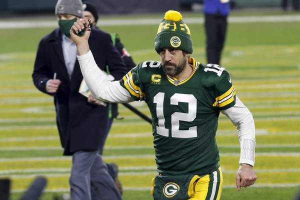 Associated Press photos Tampa Bay Buccaneers quarterback Tom Brady and Green Bay Packers quarterback Aaron Rodgers will meet for just the fourth time today in the NFC title game and first in the playoffs.