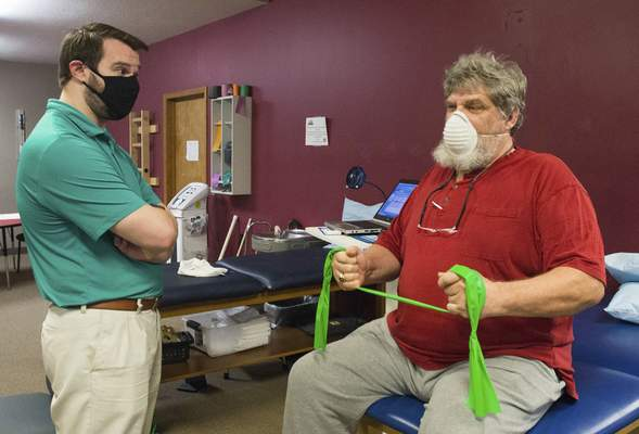 Photos by Michelle Davies | The Journal Gazette Kevin Subler, physical therapist at Indiana Physical Therapy, keeps an eye on Brad Greenbank's progress during his physical therapy session.