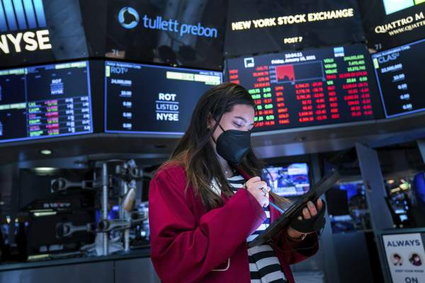 Associated Press  Trader Ashley Lara works on the floor of the New York Stock Exchange as CEOs have begun telling shareholders how much profit their companies made at the end of 2020.