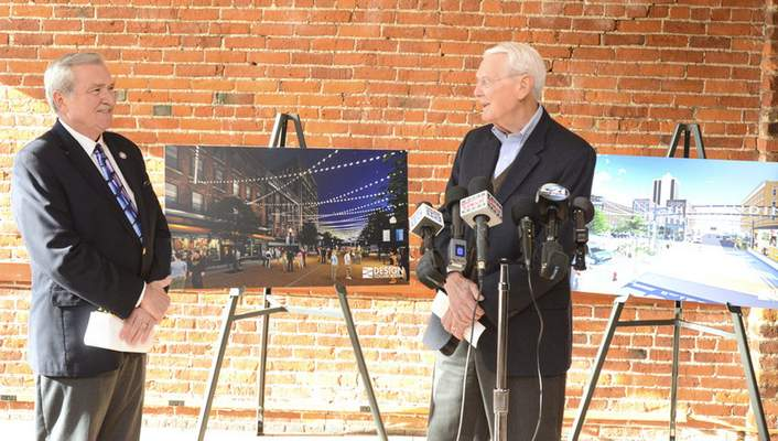 File Mac Parker, right, in his role with the Downtown Development Trust, and Mayor Tom Henry speakat a 2015news conference where redevelopment plans were revealed for The Landing, the historic block of Columbia Street west of the Rousseau Centre.