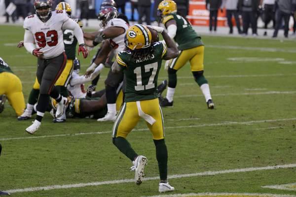 Green Bay Packers' Davante Adams (17) catches a two-yard pass against the Tampa Bay Buccaneers during the second half of the NFC championship NFL football game in Green Bay, Wis., Sunday, Jan. 24, 2021. (AP Photo/Matt Ludtke)