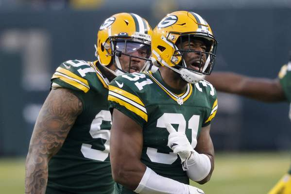 Green Bay Packers' Adrian Amos (31) reacts after intercepting a pass intended for Tampa Bay Buccaneers' Mike Evans during the second half of the NFC championship NFL football game in Green Bay, Wis., Sunday, Jan. 24, 2021. (AP Photo/Jeffrey Phelps)