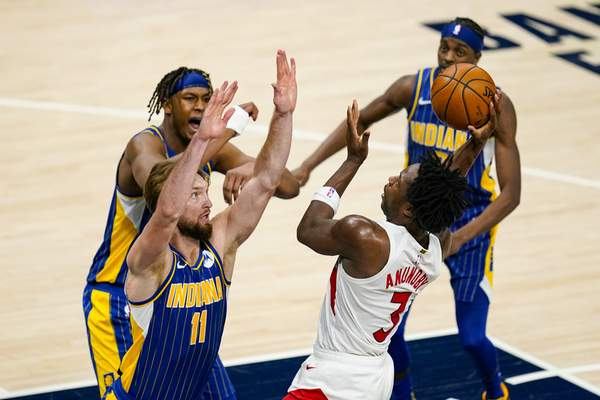 Toronto Raptors forward OG Anunoby (3) shoots over Indiana Pacers forward Domantas Sabonis (11) during the second half of an NBA basketball game in Indianapolis, Sunday, Jan. 24, 2021. (AP Photo/Michael Conroy)