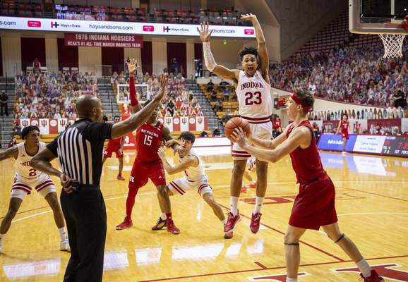Indiana forward Trayce Jackson-Davis (23) reacts as a game official after Rutgers guard Paul Mulcahy (4) was unable to in-bound the ball during an NCAA college basketball game, Sunday, Jan. 24, 2021, in Bloomington, Ind. (AP Photo/Doug McSchooler)