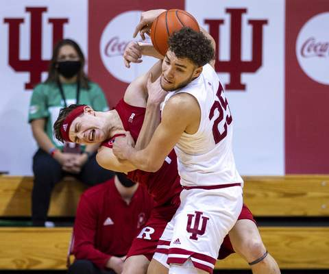Rutgers guard Paul Mulcahy, left, and Indiana forward Race Thompson, right, battle for a rebound during the second half of an NCAA college basketball game, Sunday, Jan. 24, 2021, in Bloomington, Ind. (AP Photo/Doug McSchooler)
