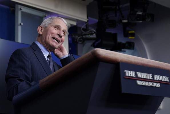 Dr. Anthony Fauci, director of the National Institute of Allergy and Infectious Diseases, speaks with reporters in the James Brady Press Briefing Room at the White House, Thursday, Jan. 21, 2021, in Washington. (AP Photo/Alex Brandon)