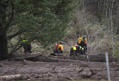 Northwest Storm Missing Woman FILE - In this Thursday, Jan. 14, 2021 file photo, Search and rescue crews use metal rods to poke through the mud as they continue to search for a missing woman whose car was swept away by a landslide Wednesday in the Dodson area of the Columbia River Gorge, in Oregon. (Brooke Herbert/The Oregonian via AP, File) (Brooke Herbert