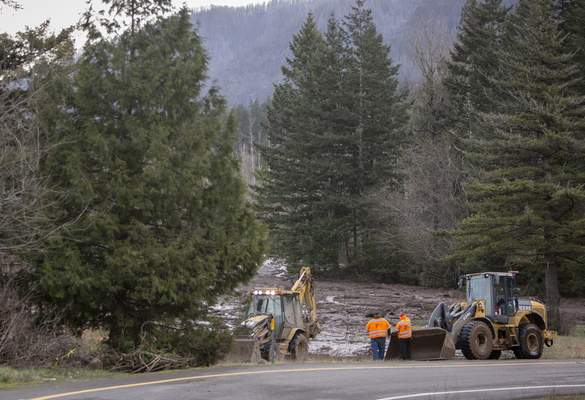FILE - In this Thursday, Jan. 14, 2021 file photo, Search and rescue crews continue to search for a missing woman whose car was swept away by a landslide the day before in the Dodson area of the Columbia River Gorge. (Brooke Herbert/The Oregonian via AP)