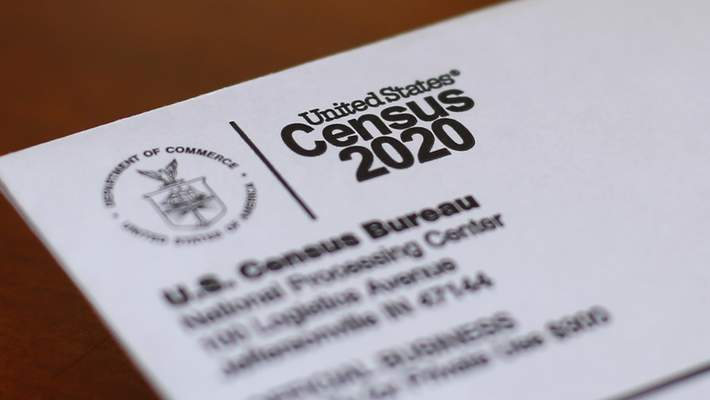 FILE - This April 5, 2020, file photo shows an envelope containing a 2020 census letter mailed to a U.S. resident in Detroit. (AP Photo/Paul Sancya, File)