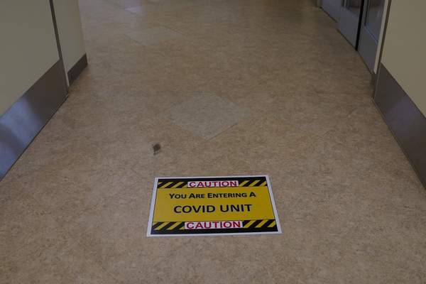 FILE - In this Jan. 7, 2021, file photo, a caution sign is placed on the floor of a COVID-19 unit at St. Joseph Hospital in Orange, Calif. (AP Photo/Jae C. Hong, File)