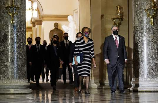 Trump Impeachment Clerk of the House Cheryl Johnson along with acting House Sergeant-at-Arms Tim Blodgett, lead the Democratic House impeachment managers as they walk through Statuary Hall in the Capitol, to deliver to the Senate the article of impeachment alleging incitement of insurrection against former President Donald Trump, Monday, Jan. 25, 2021 in Washington. (AP Photo/Susan Walsh) (Susan WalshSTF)
