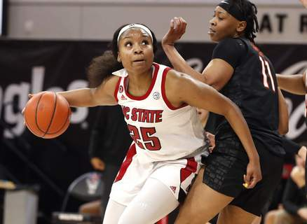 Virginia Tech NC State Basketball North Carolina State's Kayla Jones (25) drives around Virginia Tech's D'asia Gregg (11) during the first half of an NCAA college basketball game, Sunday, Jan. 24, 2021 in Raleigh, N.C. (Ethan Hyman/The News & Observer via AP) (Ethan Hyman